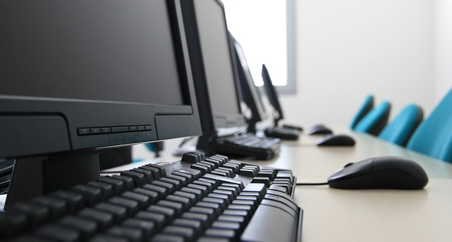 a row of desktop computers