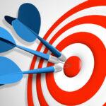 a handful of darts in a bullseye