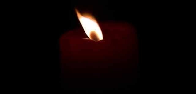 a candle in a dark room