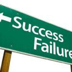 sign displaying success and failure in different directions